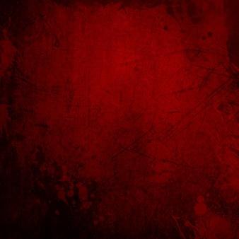 Detaillierter roter grunge-hintergrund mit spritzer und flecken