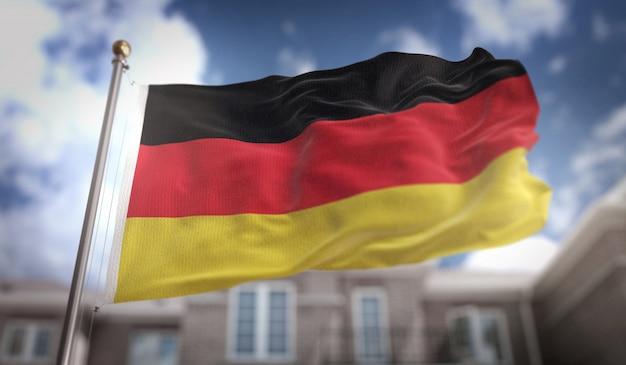 Deutschland flagge 3d rendering auf blauem himmel gebäude hintergrund
