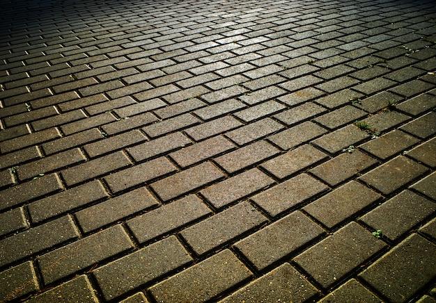 Diagonale fliesen des straßenpflasterhintergrundes