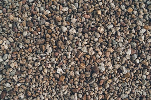 Die beschaffenheit von kleinen steinen, draußen küste.
