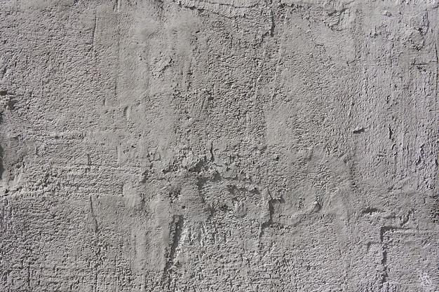 Die betonoberfläche des putzes als hintergrund für die gestaltung