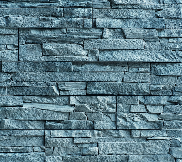 Die blöcke aus massivem steindie wand aus grauem steinvintage rustikaler verwitterter unebener hintergrund