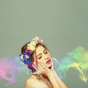 Die dame der blumen ist halbblutkaukasier und asiat. sie ist fasziniert von dem geruch bunter parfums.