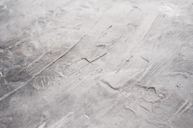Die enge struktur der grauen oberfläche des dunklen hintergrunds. grauer hintergrund für designer