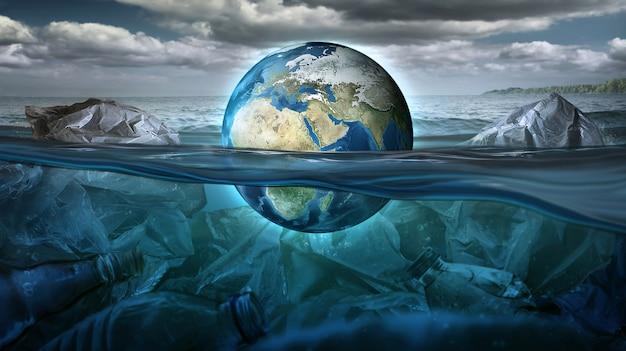 Die erde schwimmt im meer voller müll und umweltverschmutzung. umweltkonzept. erdbild von der nasa zur verfügung gestellt