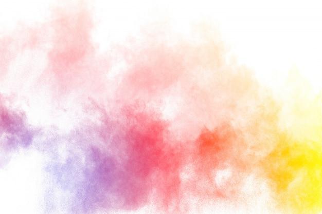 Die explosion von buntem holi-pulver. schönes regenbogenfarbenpulver fliegen weg.