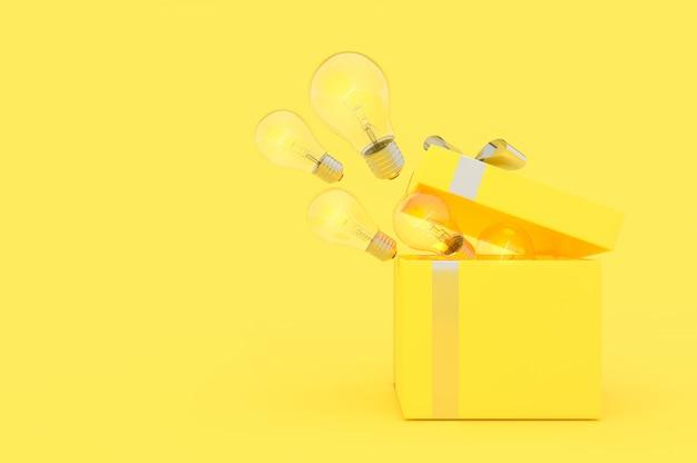Die glühbirne löste sich aus der gelben farbe der geschenkbox