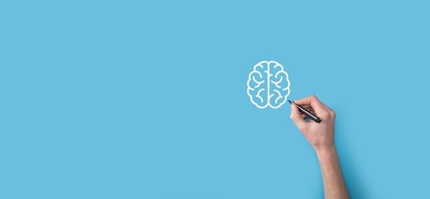 Die hand des mannes zeichnet abstrakte gehirn- und symbolwerkzeuge, geräte, kundennetzwerkverbindungskommunikation auf virtueller, innovativer entwicklung, zukunftstechnologie, wissenschaft, innovation und geschäftskonzept.