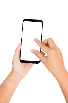 Die hand, die mobiltelefon- und fingeraktion hält, vergrößern schirm, weißen schirm und hintergrund