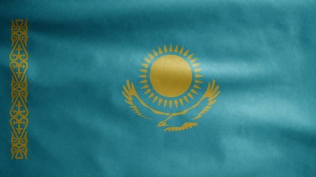 Die kasachische flagge weht im wind. nahaufnahme von kasachstan banner weht, weiche und glatte seide. stoff textur fähnrich hintergrund. verwenden sie es für das konzept für nationalfeiertage und länderanlässe.