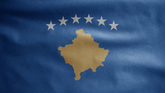 Die kosovarische flagge weht im wind. nahaufnahme von kosovo-banner weht, weiche und glatte seide. stoff textur fähnrich hintergrund.