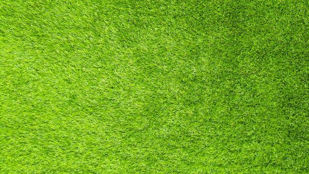 Die künstliche musterbeschaffenheit des grünen grases.