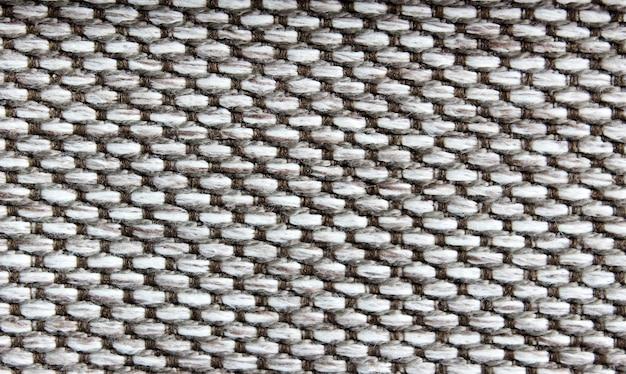 Die leinwand aus einem wollstoff in graumelierter farbe. ansicht von oben, stoffbeschaffenheit.
