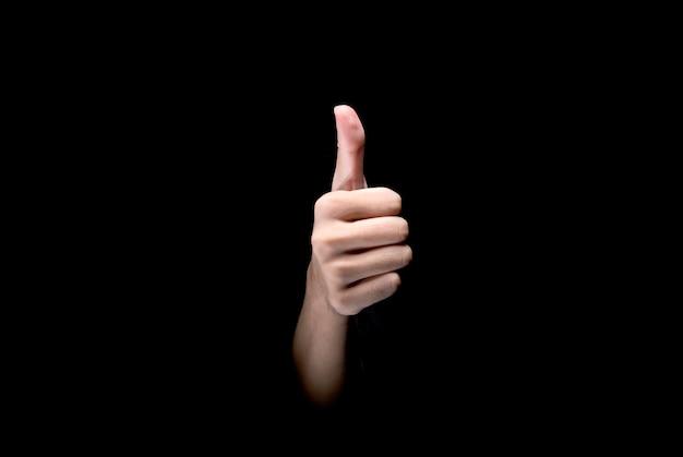 Die männlichen hände, die daumen zeigen, up geste