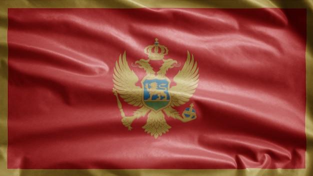 Die montenegrinische flagge weht im wind. montenegro banner weht weiche seide