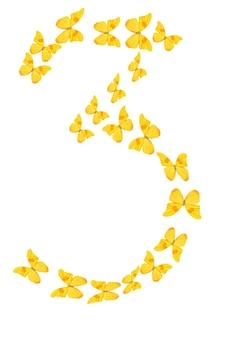 Die nummer drei von gelben tropischen schmetterlingen isoliert auf weißem hintergrund.