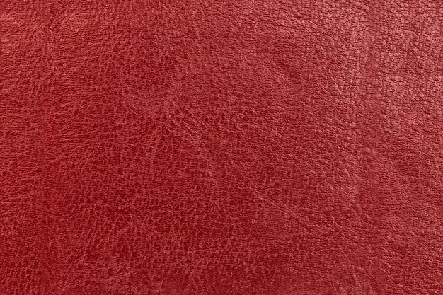 Die oberfläche und textur von altem leder in rot.