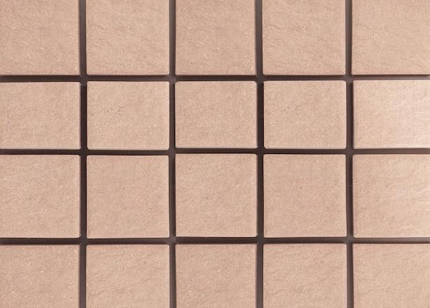Die sandsteinmauer ist eine quadratische wand, die in einer reihe angeordnet ist. hintergrund.
