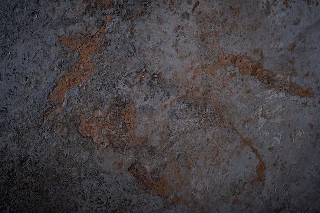 Die schwarze textur der betonwand ist eine raue form. der alte steinbodenschmutz