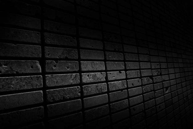 Die schwarze wandoberfläche verwendet viele ziegel. oder altes abstraktes muster der schwarzen backsteinmauer