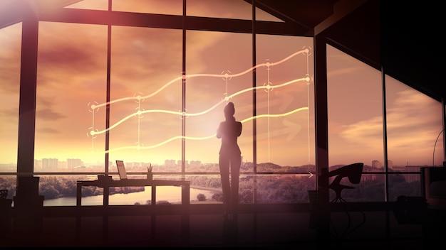 Die silhouette einer geschäftsfrau betrachtet die infografiken bei sonnenuntergang