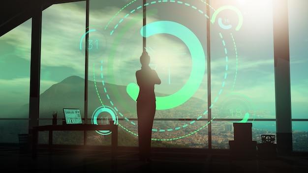 Die silhouette einer geschäftsfrau in einem anzug betrachtet virtuelle infografiken