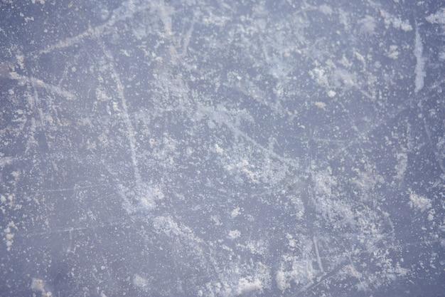 Die textur der eisbahn, schlittschuh, nahaufnahme. öffnen sie eisbahn winterhintergrund