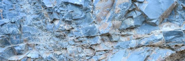 Die textur der oberfläche des graublauen natursteins rockt als hintergrund. banner