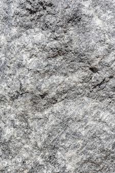 Die textur der oberfläche von grauem quarz ein muster auf einem felsen natursteinhintergrund