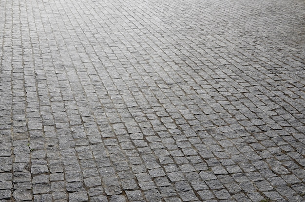 Die textur der pflasterplatte (pflastersteine) von vielen