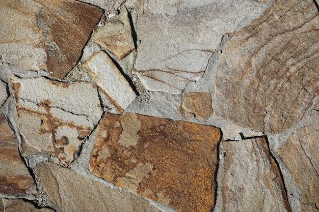 Die textur der steine. stein strukturierte fliese. steinmuster auf der fliese.