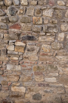 Die textur der steinmauer. hintergrund von steinen, die übereinander gestapelt sind.