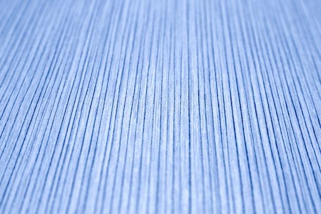 Die textur des gestreiften papiers in hellblauer farbe