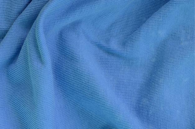 Die textur des gewebes in blauer farbe.