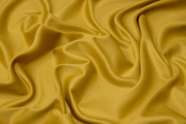 Die textur des kaschmirgewebes beige. hintergrundmuster.