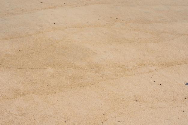 Die textur des meersandes an einem strand