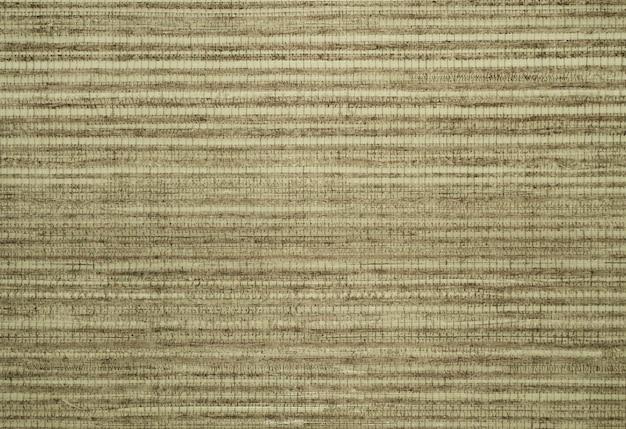 Die textur des retro-wandteppich-hintergrundes mit abgestreiftem gittermuster
