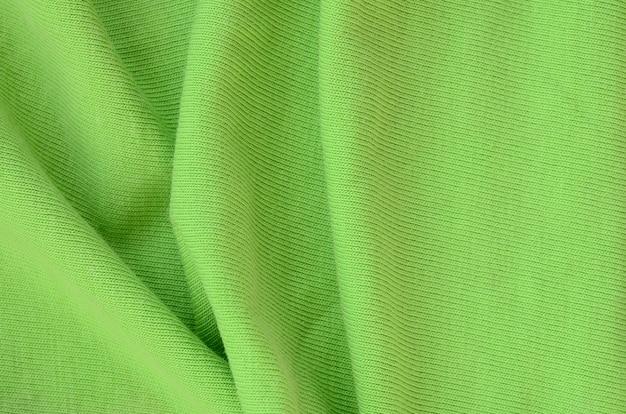 Die textur des stoffes ist hellgrün. material zur herstellung von hemden und blusen