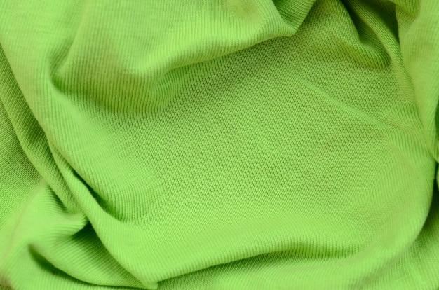 Die textur des stoffes ist hellgrün.