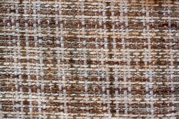 Die textur des stoffes. kreuzweben. flauschige braune und weiße fäden. platz kopieren.