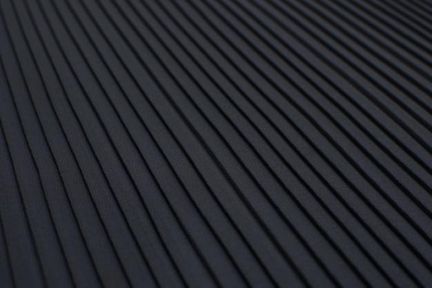 Die textur des synthetischen gewebes ist grau. plisse.