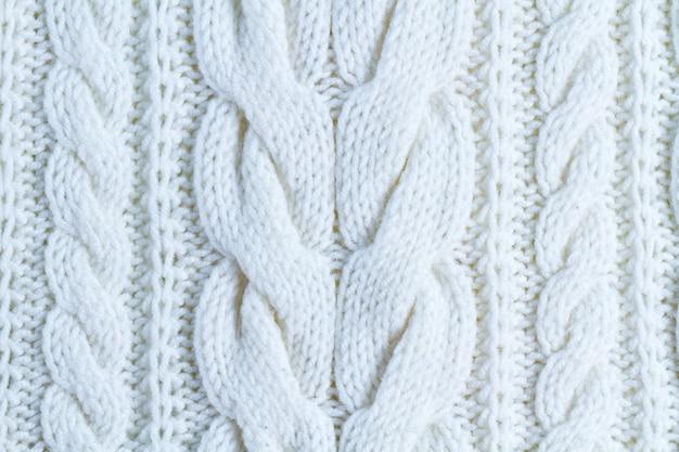 Die textur des weißen garns. gestrickte und winterkleidung