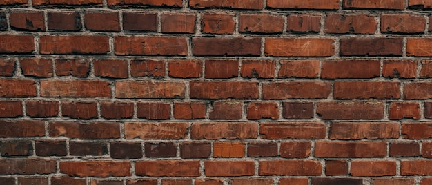 Die textur einer alten backsteinmauer mit natürlichen mängeln kratzer risse spalten späne staubrauhigkeit...