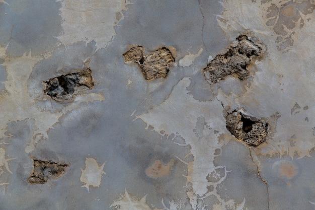 Die textur einer alten chinesischen steinmauer aus steinkorallen und muscheln