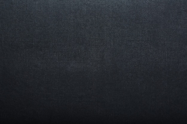 Die textur einer schwarzen leeren seitentafel für pastellfarben. schwarzer hintergrund der papierbeschaffenheit.
