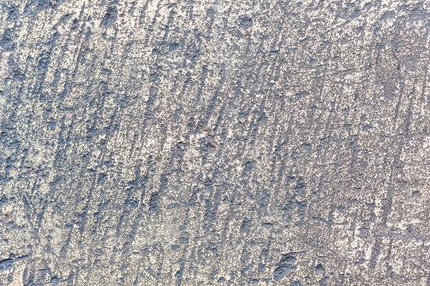 Die textur eines alten grau verarbeiteten steins