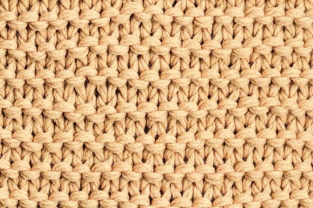 Die textur eines braunen strickgarns. gestrickte und winterkleidung