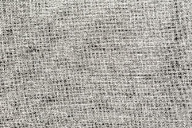 Die textur eines dichten grauen stoffes als natürlicher hintergrund