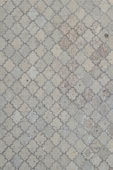 Die textur eines rhythmischen mosaiks aus betonfliesen.