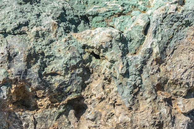 Die textur und das muster des natürlichen minerals ist grüner steinhintergrund